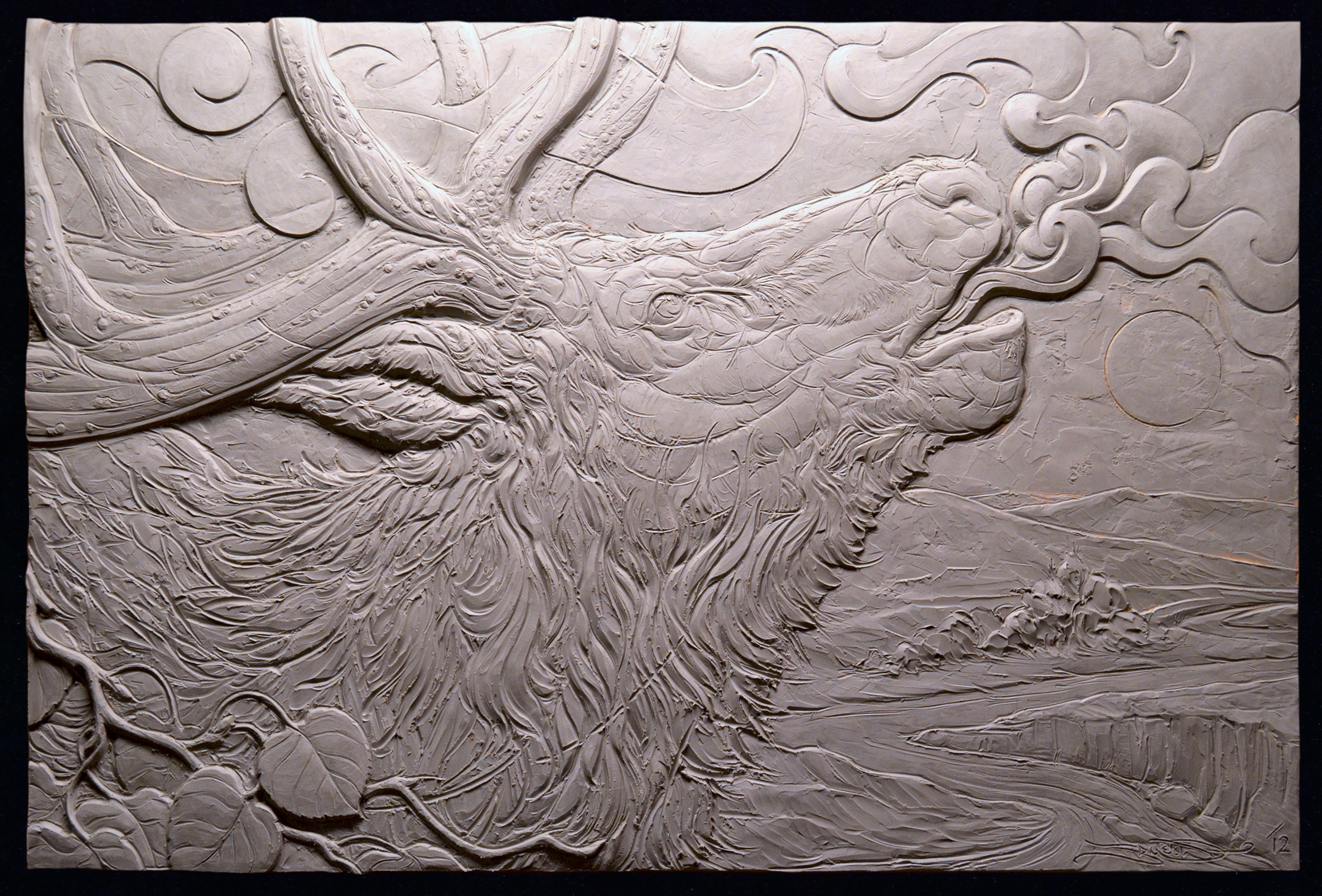 Image of clay process (grey). Finished product in bronze.